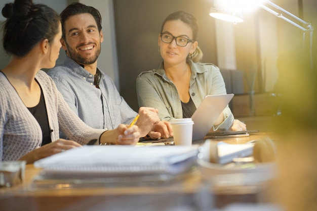 Colleagues workshopping business ideas in modern co working space Premium Photo