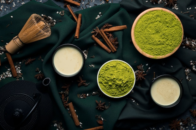 Collection of asian tea matcha ingredients on cloth Free Photo