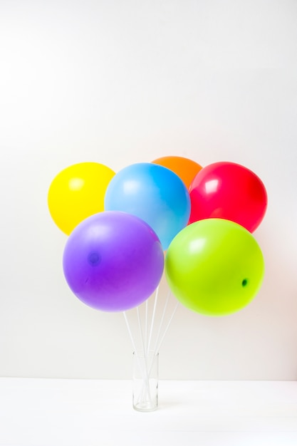 Collection of bright balloons in glass Free Photo