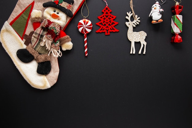 Collection of christmas ornaments on black background Free Photo