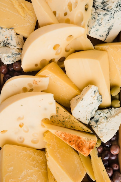 Collection of fresh cheese slices with olives Free Photo