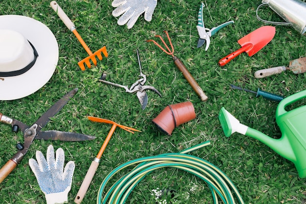Collection of garden equipment on meadow Free Photo