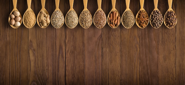 Collection of indian spices and herbs on wooden spones Premium Photo