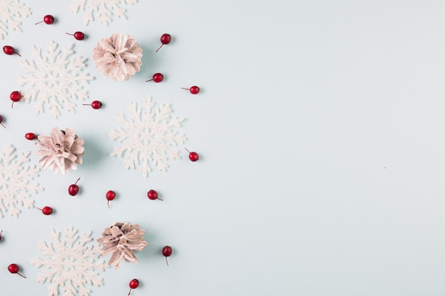 Collection of paper snowflakes, snags and berries Free Photo