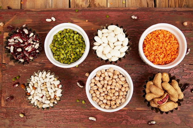 Collection set of beans and legumes. bowls of various lentils Premium Photo