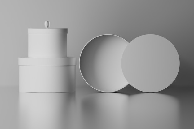 Collection set of round gift packaging boxes with blank surfaces on mirror glossy floor Premium Photo