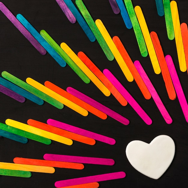 Collection of sticks in bright lgbt colors and decorative heart Free Photo