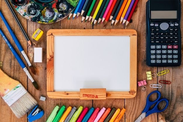 Collection supplies with back to school on wooden background. Premium Photo