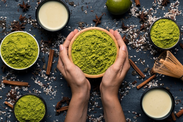 Collection of two hands holding matcha tea bowl Free Photo