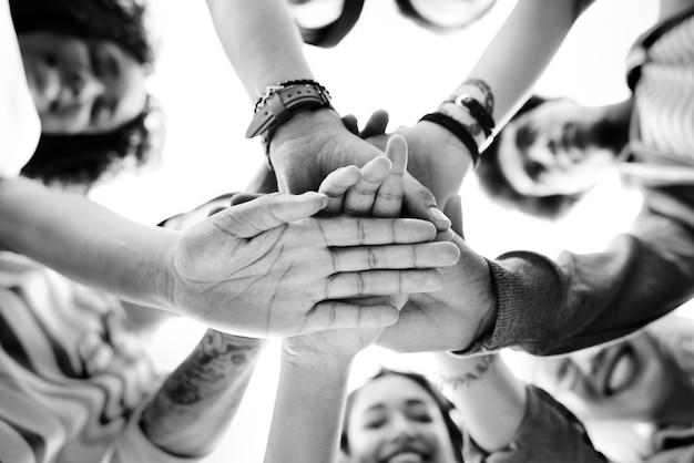 College students teamwork stacking hand concept Premium Photo
