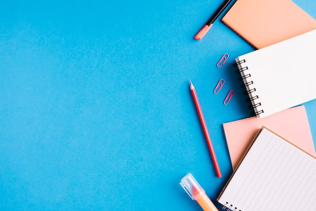 College supplies on blue surface
