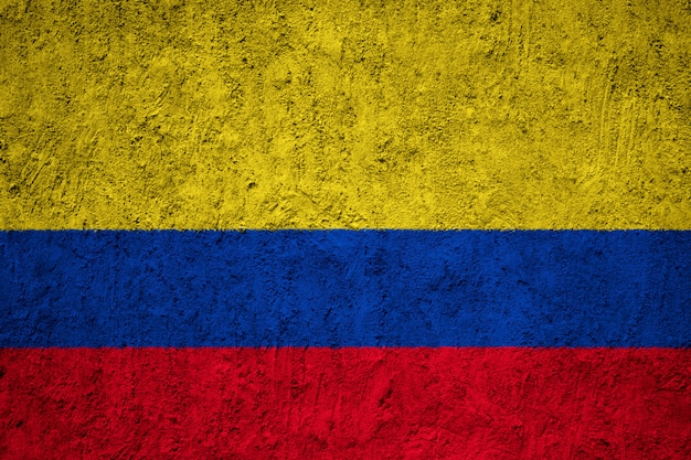 Colombia flag on concrete wall Premium Photo
