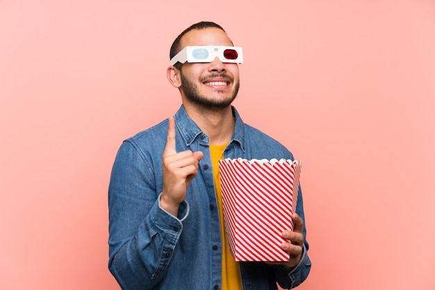 Colombian man with popcorns pointing with the index finger a great idea Premium Photo