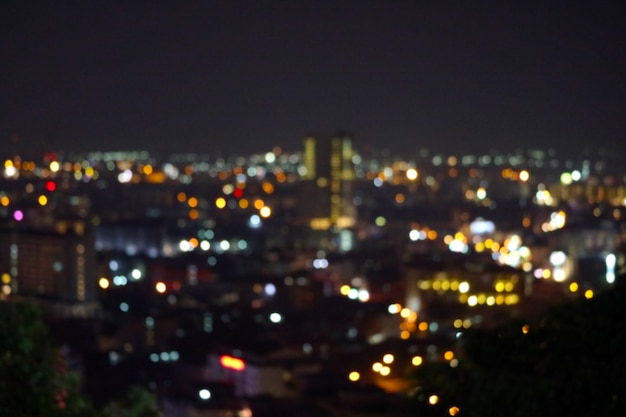 Color abstract of blur rainbow light of city in night sky Premium Photo