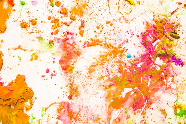 Color dust particles splattered on white background Free Photo