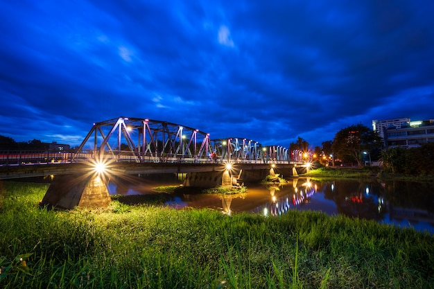 The color of the lights on the iron bridge at twlight time in chiang mai,thailand. Premium Photo