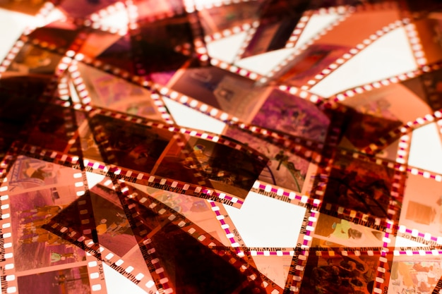Color negative 35mm film stripes on a light box Free Photo