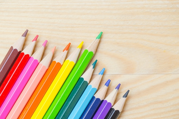 Color pencil on wood background, colorful kids school ...