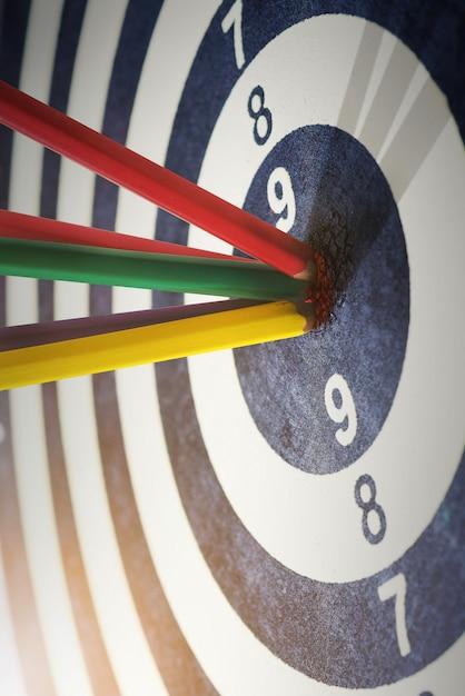 Color pencils in bull's eye success hitting target aim goal achievement concept background Premium Photo