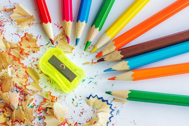 Color pencils, shavings from pencils and a sharpener Premium Photo