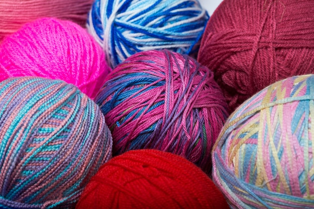Colored balls of yarn. view from above. rainbow colors. all colors. yarn for knitting. skeins of yarn. Premium Photo