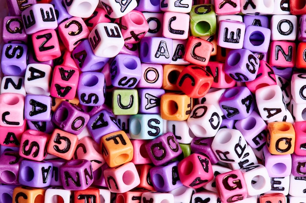 Colored cubes with english letters close-up.texture and background concept. Premium Photo
