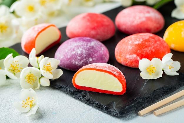 Colored japanese ice cream mochi in rice dough. Premium Photo