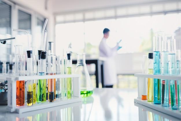 Colored liquids in test tube in laboratory Premium Photo