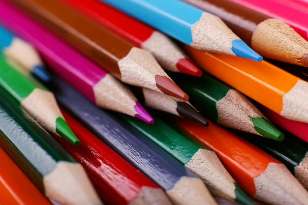 Colored pencils background Premium Photo