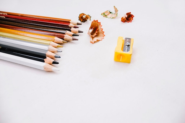 Colored pencils and sharpener Free Photo