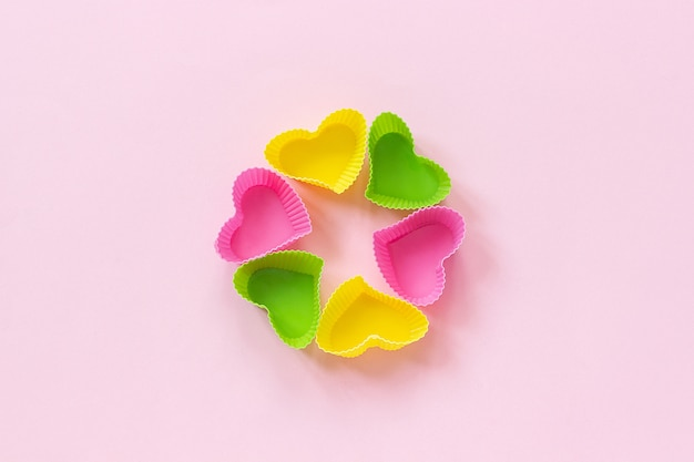 Colored silicone heart shaped molds dish for baking cupcakes Premium Photo