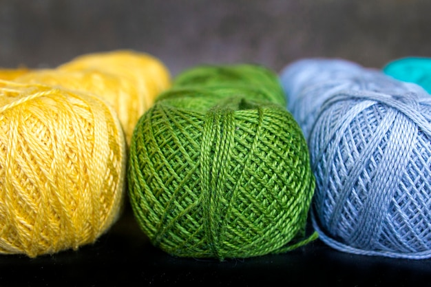 Colored threads for knitting background Premium Photo