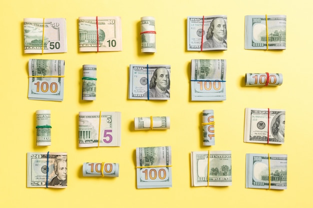 Colored  with money american hundred dollar bills on top wiev with copyspace for your text in business Premium Photo