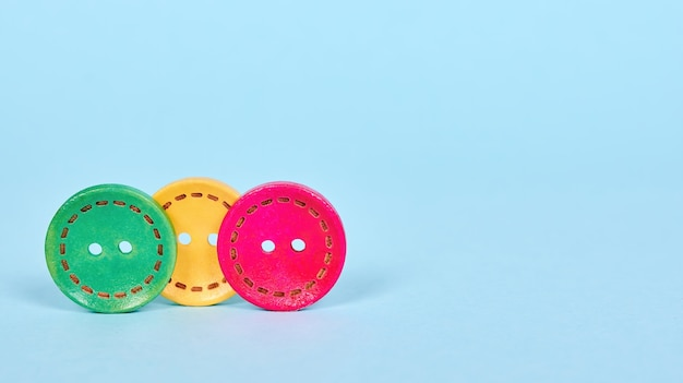 Colored wooden sewing buttons, hobby craft. isolated. Premium Photo
