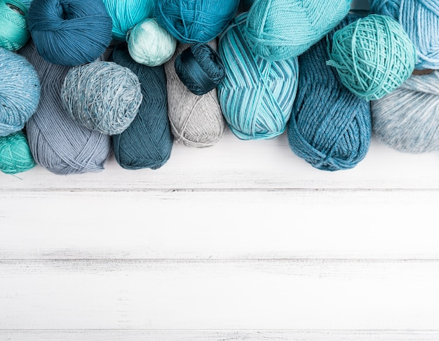 Colored wool yarn with copy space Free Photo
