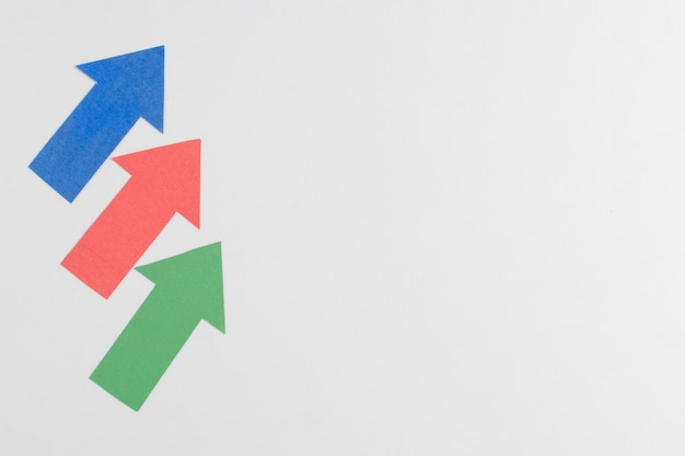 Colorful arrows and copy space Free Photo