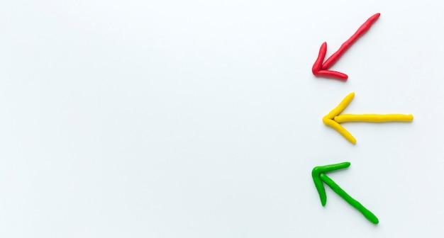 Frecce colorate con spazio di copia Foto Gratuite