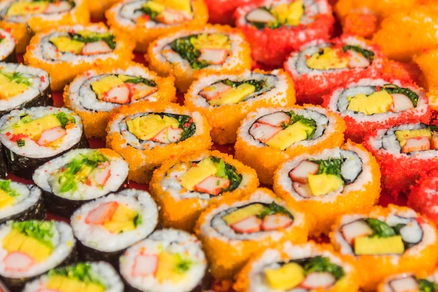 Colorful assortment of sushi rolls Free Photo
