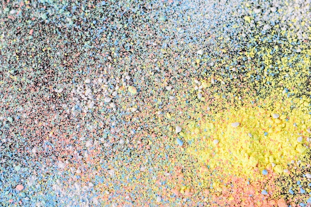 Colorful background of chalk powder. multicolored dust particles splattered. Premium Photo