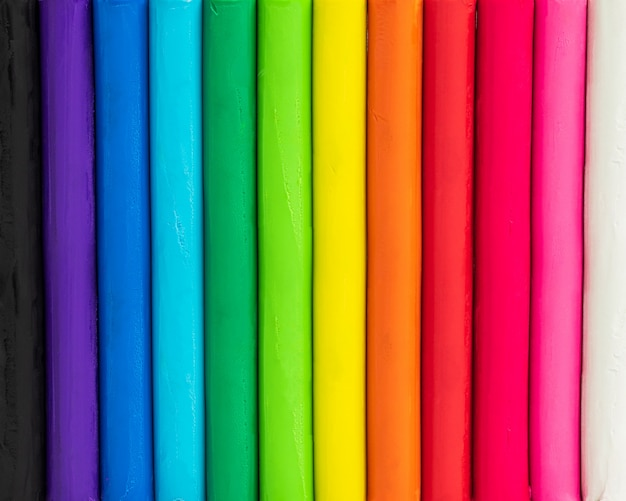 Colorful background of plasticine. multicolor of modelling clay texture. Premium Photo