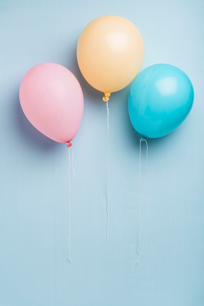 Colorful balloons on blue background with copy space Free Photo