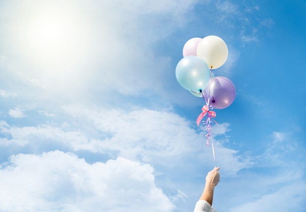 Colorful balloons flying on sky. Free Photo