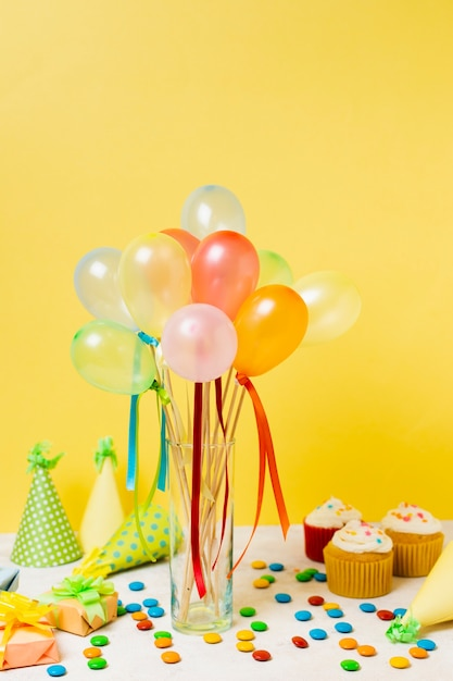 Colorful balloons on table Free Photo