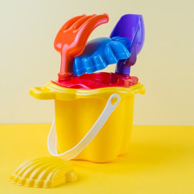 Colorful beach toy on colored backdrop Free Photo