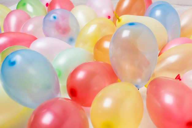 Colorful birthday balloons close-up background Free Photo