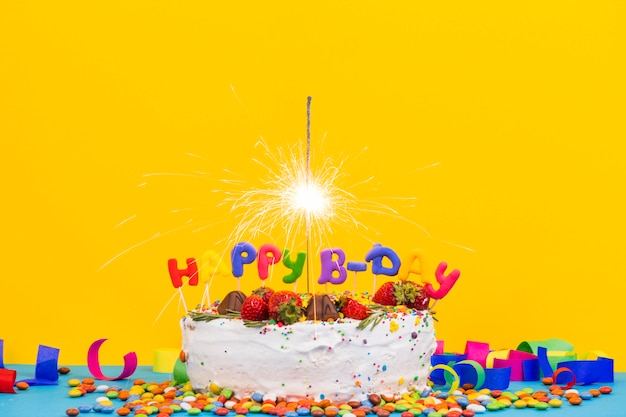 Colorful Birthday Cake With Sparkler Free Photo