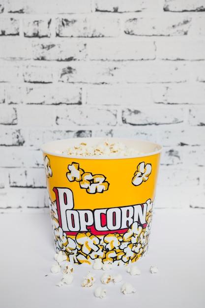 Colorful bucket of popcorn on white Free Photo