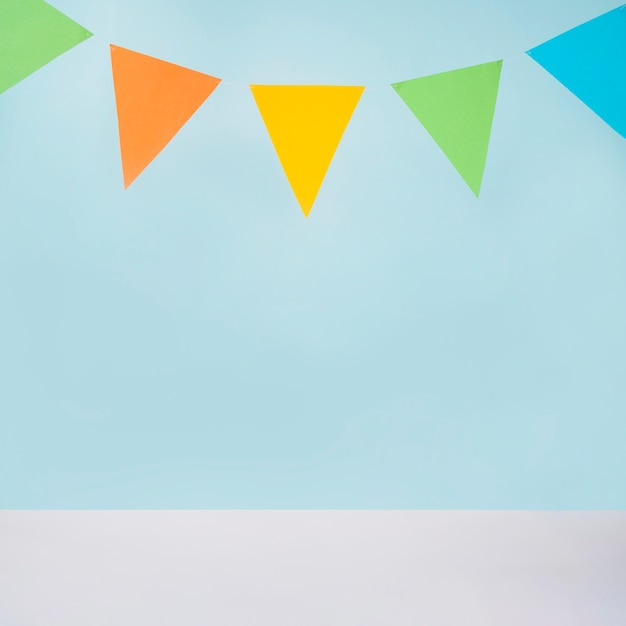 Colorful bunting on blue background Free Photo
