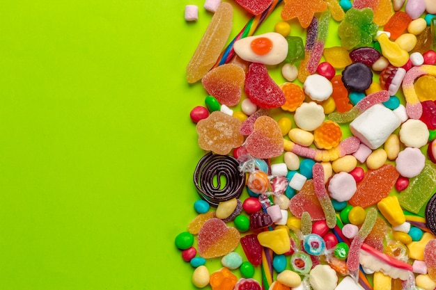 Colorful candies on green Premium Photo