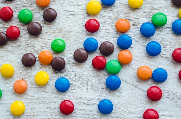 Colorful candies on white background Premium Photo
